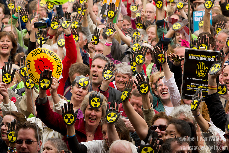 Demonstrators protest at an Anti Nuclear Rally held on the Dam Square in Amterdam, the Netherlands on April 16, 2011. Thousands of people gathered on the square to protest recent Netherlands government movements to increase nuclear power in the country.
