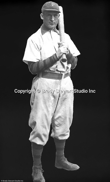 Pittsburgh PA:  View of Honus Wagner posing for a photograph with the bat on his left shoulder.  My grandfather said he did it to see if anyone would notice.  The shot was taken for a local advertising campaign;  the background was removed so the image could be printed on a white background.  Not the greatest job of taking out the background by my grandfather