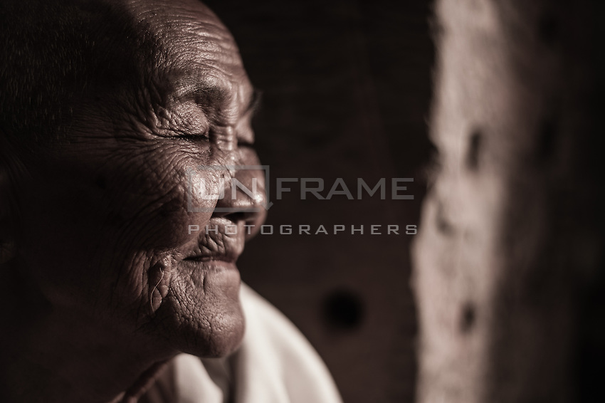 UNESCO World Heritage Site,  Ankgor wat temples and portraits of local elder woman who  make her living by selling crafts and other products to tourists.   Seam Reap, Cambodia.