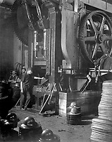 Manufacturing helmets.  Large power press for shaping helmets in the plant of Hale & Kilburn Corp., Phila., Pa. Ca.  1918.  Hale & Kiburn Corp.  (War Dept.)<br /> Exact Date Shot Unknown<br /> NARA FILE #:  165-WW-59C-6<br /> WAR & CONFLICT BOOK #:  549