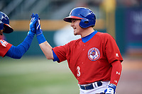 Buffalo Bisons designated hitter Reese McGuire (3) high fives Lourdes Gurriel Jr. (13) on his way back to the dugout after Gurriel Jr. hit a grand slam home run in the fourth inning during a game against the Scranton/Wilkes-Barre RailRiders on May 18, 2018 at Coca-Cola Field in Buffalo, New York.  Buffalo defeated Scranton/Wilkes-Barre 5-1.  (Mike Janes/Four Seam Images)