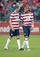 03 June 2012: US Men's National Soccer Team defender Clarence Goodson #21and US Men's National Soccer Team defender Oguchi Onyewu #5 in action during an international friendly  match between the United States Men's National Soccer Team and the Canadian Men's National Soccer Team at BMO Field in Toronto..The game ended in 0-0 draw...