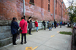 BROOKLYN, NY — OCTOBER 27, 2020:  People wait in line to vote outside of the Park Slope Armory during early voting for the 2020 U.S. presidential election on October 27, 2020 in the Brooklyn borough of New York City.  Photograph by Michael Nagle
