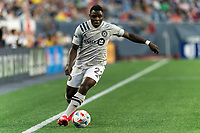 FOXBOROUGH, MA - JULY 25: Sunusi Ibrahim #22 of CF Montreal dribbles down the wing during a game between CF Montreal and New England Revolution at Gillette Stadium on July 25, 2021 in Foxborough, Massachusetts.