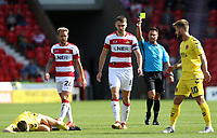 Doncaster Rovers' Ben Whiteman is booked by referee James Adcock<br /> <br /> Photographer David Shipman/CameraSport<br /> <br /> The EFL Sky Bet League One - Doncaster Rovers v Fleetwood Town - Saturday 17th August 2019  - Keepmoat Stadium - Doncaster<br /> <br /> World Copyright © 2019 CameraSport. All rights reserved. 43 Linden Ave. Countesthorpe. Leicester. England. LE8 5PG - Tel: +44 (0) 116 277 4147 - admin@camerasport.com - www.camerasport.com