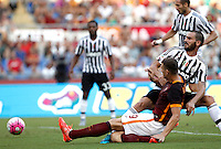 Calcio, Serie A: Roma vs Juventus. Roma, stadio Olimpico, 30 agosto 2015.<br /> Roma's Edin Dzeko and Juventus' Leonardo Bonucci, right, fight for the ball during the Italian Serie A football match between Roma and Juventus at Rome's Olympic stadium, 30 August 2015.<br /> UPDATE IMAGES PRESS/Isabella Bonotto