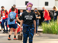 HOUSTON, TX - JUNE 10: Megan Rapinoe #15 of the USWNT walks into the stadium before a game between Portugal and USWNT at BBVA Stadium on June 10, 2021 in Houston, Texas.