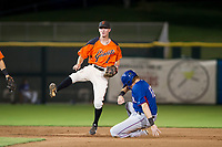 AZL Giants second baseman Kyle McPherson (7) avoids a slide by Sam Huff (12) on a double play attempt against the AZL Rangers on September 4, 2017 at Scottsdale Stadium in Scottsdale, Arizona. AZL Giants defeated the AZL Rangers 6-5 to advance to the Arizona League Championship Series. (Zachary Lucy/Four Seam Images)