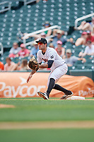 Birmingham Barons first baseman Nick Basto (20) stretches to receive a throw during a game against the Pensacola Blue Wahoos on May 9, 2018 at Regions FIeld in Birmingham, Alabama.  Birmingham defeated Pensacola 16-3.  (Mike Janes/Four Seam Images)