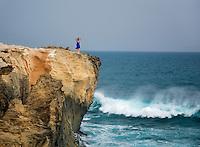 Woman viewing ocean. Kauai, Hawaii