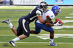 Nevada's Albert Rosette tackles Boise State runningback D.J. Harper during the second half of an NCAA college football game on Saturday, Dec. 1, 2012,  in Reno, Nev. Boise State won 27-21. (AP Photo/Cathleen Allison)