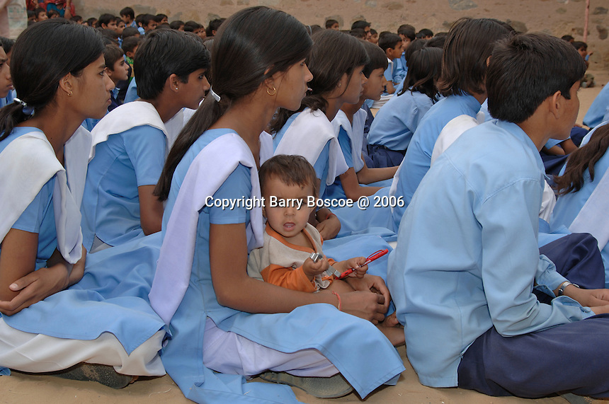 School children waiting quitely in the school yard for a show in Rajasthan, India
