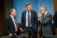 Belgian finance minister Johan Van Overtveldt (C) talks with Klaus Regling, from Germany, Managing Director of the European Stability Mechanism (ESM)   at the start of a Eurogroup with European Finance Ministers meeting at EU council headquarters in Brussels, Belgium on 26.01.2015 The Eurogroup's meeting focus on Greece, after  leftist anti-bailout party SYRIZA won parliamentary elections by Wiktor Dabkowski