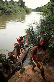 A-Ukre village, Brazil. Kayapo women on a fruit collecting expedition with dugout canoe; Xingu.