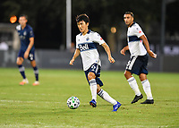 LAKE BUENA VISTA, FL - JULY 26: Hwang In-Beom of Vancouver Whitecaps FC looks for options during a game between Vancouver Whitecaps and Sporting Kansas City at ESPN Wide World of Sports on July 26, 2020 in Lake Buena Vista, Florida.