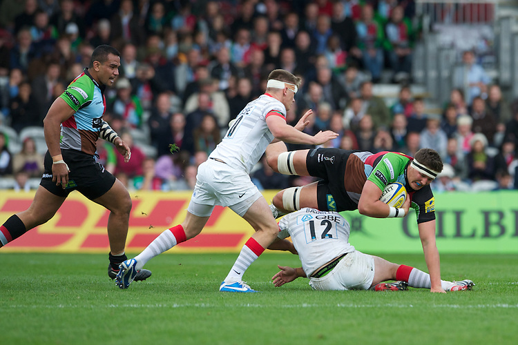 Charlie Matthews of Harlequins is tackled by Brad Barritt of Saracens as Owen Farrell of Saracens (left) supports during the Aviva Premiership match between Harlequins and Saracens at the Twickenham Stoop on Sunday 30th September 2012 (Photo by Rob Munro)