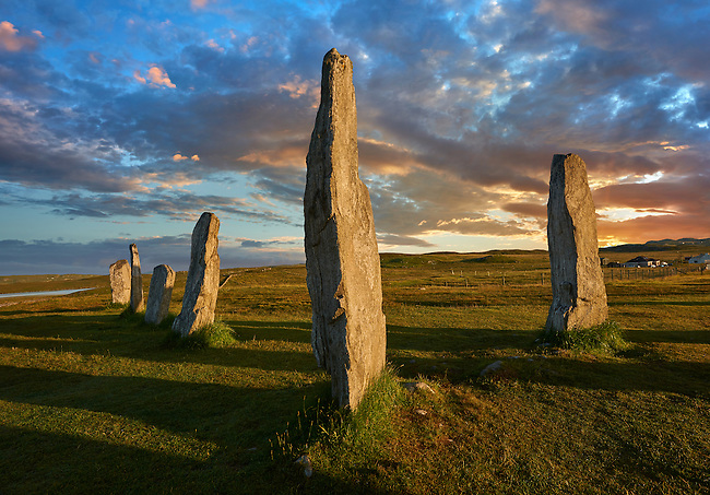 Outer row of stones, 27 metres long, at sunset,  leading to the central stone circle, circa 2900BC.  Calanais Neolithic Standing Stone (Tursachan Chalanais) , Isle of Lewis, Outer Hebrides, Scotland.