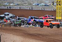 Mar. 20, 2011; Chandler, AZ, USA;  LOORRS pro four driver Ricky Johnson (48) races alongside Adrian Cenni (11) during round two at Firebird International Raceway. Mandatory Credit: Mark J. Rebilas-
