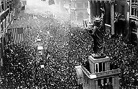 The announcing of the armistice on Nov. 11, 1918, was the occasion for a monster celebration in Phila., Pa.  Thousands massed on all sides of the replica of the Statue of Liberty on Broad Street, and cheered unceasingly.  Philadelphia Public Ledger.  (War Dept.)<br /> NARA FILE #:  165-WW-78A-2<br /> WAR & CONFLICT BOOK #:  715