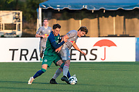 HARTFORD, CT - JULY 10: Austin Brummett #71 of New York Red Bulls II dribbles as Arthur Rogers #6 of Hartford Athletic defends during a game between New York Red Bulls II and Hartford Athletics at Dillon Stadium on July 10, 2021 in Hartford, Connecticut.