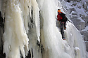 "22/01/13..Mark Procter (orange helmet) was the first climber to make the climb today...After many days below zero a giant waterfall has now frozen solid attracting climbers to tackle the huge 30 metre ascent up the freshly formed icicles and towers of ice. Known as Kinder Downfall the waterfall is the tallest in the Peak District. The river Kinder cascades over the top of the Kinder Scout plateau near the Pennine Way 2,087 ft above sea level mid-way between the villages of Hayfield and Edale in the High Peak of Derbyshire...Finding out when the waterfall is ready to climb is shrouded in secrecy. One of the six climbers who scaled the frozen spectacle today said: ""There's lots of misinformation on the internet, everyone wants to be the first to climb it as soon as it's in condition to climb""...The climb up to the face of the waterfall took many hours today with climbers trudging through waist-deep snow-drifts before strapping on their crampons and using ice axes to scale the Downfall...All Rights Reserved - F Stop Press.  www.fstoppress.com. Tel: +44 (0)1335 300098."