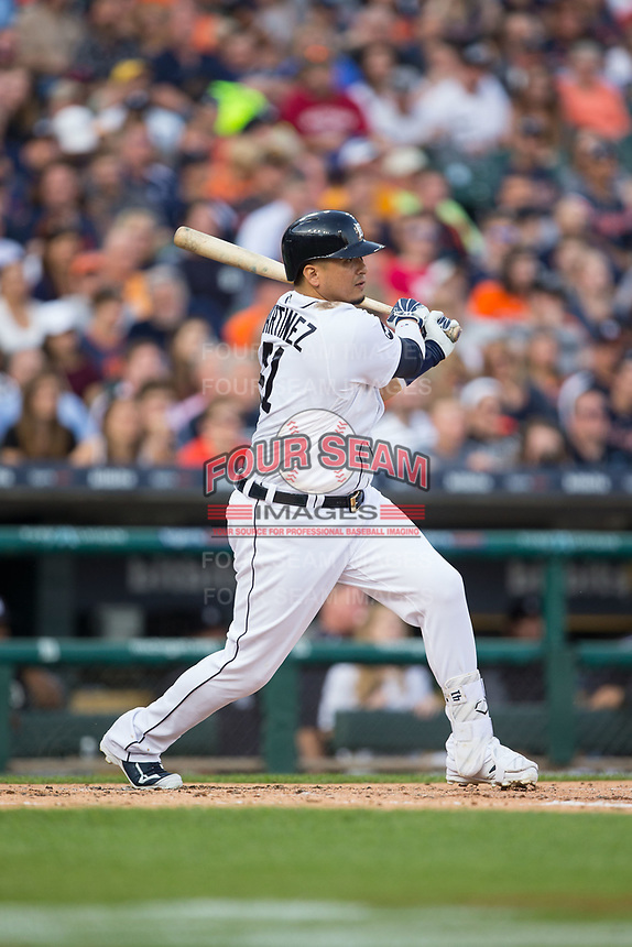 Victor Martinez (41) of the Detroit Tigers follows through on his swing against the Chicago White Sox at Comerica Park on June 2, 2017 in Detroit, Michigan.  The Tigers defeated the White Sox 15-5.  (Brian Westerholt/Four Seam Images)