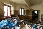 """Das ehemalige St. Josefsheim Waldniel-Hostert, Fuehrung durch das Heim mit der Kentschool Security Group, Muell, Abfall, Geruempel, niemand, [das Josefsheim ist ein ehemaliges Franziskaner-Heim fuer Kinder mit Behinderung, nach 1937 war es die Kinderfachabteilung der Provinzial Heil- und Pflegeanstalt, in dieser Zeit wurden ca. 100 Kindern mit Behinderung durch die Nationalsozialisten ermordet, von 1963 bis 1991 britische Kent-School], heute leerstehende Ruine, [Treffpunkt fuer """"Geisterjaeger""""], lost place, lost places, moderne Ruine, Verfall, verfallen, Gedenkstaette, Euthanasie, Kindereuthanasie, Naziverbrechen, Verbrechen, Behinderung, Nationalsozialismus, Nazi-Zeit, Drittes Reich, Geschichte, Historie, Josefs-Heim, Europa, Deutschland, Nordrhein-Westfalen, Viersen, Schwalmtal, 08/2013<br /> <br /> Engl.: Europe, Germany, North Rhine-Westphalia, Viersen, Schwalmtal, former St. Josefsheim Waldniel-Hostert, guided tour through the home with the Kentschool Security Group, building, interior view, waste, dump, memorial site, euthanasia, mercy killing, crime, disability, National Socialism, Third Reich, history, the Josefsheim is a former home managed by Franciscan monks for disabled children, after 1937 the National Socialists killed approx. 100 disabled children there, from 1963 - 1991 British Kent-School, August 2013"""