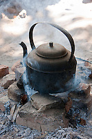 Myanmar, Burma.  Mingun, near Mandalay.  Tea Pot Sitting on a Fire.