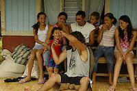 The children of a local family in Sevegre, Costa Rica prepare for a portrait.