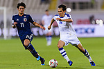 Otabek Shukurov of Uzbekistan (R) fights for the ball with Kitagawa Koya of Japan (L) during the AFC Asian Cup UAE 2019 Group F match between Japan (JPN) and Uzbekistan (UZB) at Khalifa Bin Zayed Stadium on 17 January 2019 in Al Ain, United Arab Emirates. Photo by Marcio Rodrigo Machado / Power Sport Images