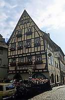 Bad Wimpfen: House of Fachwerk design with window boxes and signage. Photo '87