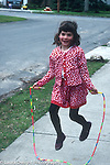 6 year old girl outside jumping rope