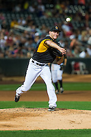 Salt Lake Bees starting pitcher Drew Rucinski (22) throws to first base against the Tacoma Rainiers in Pacific Coast League action at Smith's Ballpark on August 31, 2015 in Salt Lake City, Utah.  Salt Lake defeated Tacoma 6-5. (Stephen Smith/Four Seam Images)