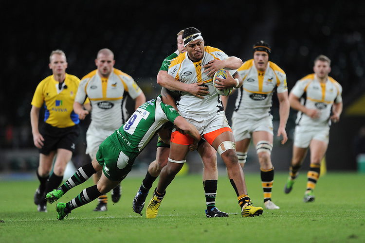 Nathan Hughes of Wasps is tackled by Scott Steele and Tom Court of London Irish during the Premiership Rugby match between London Irish and Wasps - 28/11/2015 - Twickenham Stadium, London<br /> Mandatory Credit: Rob Munro/Stewart Communications