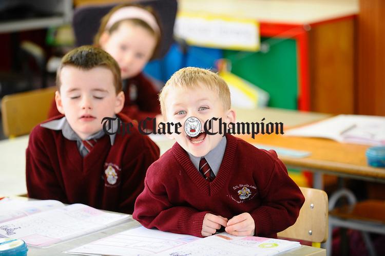Aidan O Meara, right,  and friend Gavin Guthrie react to the camera  at Ballyea NS. Photograph by John Kelly.