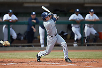 Nate Soria (5) of the Xavier Musketeers follows through on his swing against the Penn State Nittany Lions at Coleman Field at the USA Baseball National Training Center on February 25, 2017 in Cary, North Carolina. The Musketeers defeated the Nittany Lions 10-4 in game one of a double header. (Brian Westerholt/Four Seam Images)