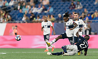 FOXBOROUGH, MA - JULY 18: Luis Caicedo #27 tackles Yordy Reyna #29 during a game between Vancouver Whitecaps and New England Revolution at Gillette Stadium on July 18, 2019 in Foxborough, Massachusetts.