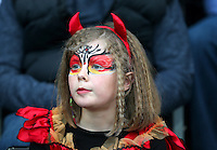 A fan wearing Halloween themed fancy dress during the Barclays Premier League match between Swansea City and Arsenal played at The Liberty Stadium, Swansea on October 31st 2015