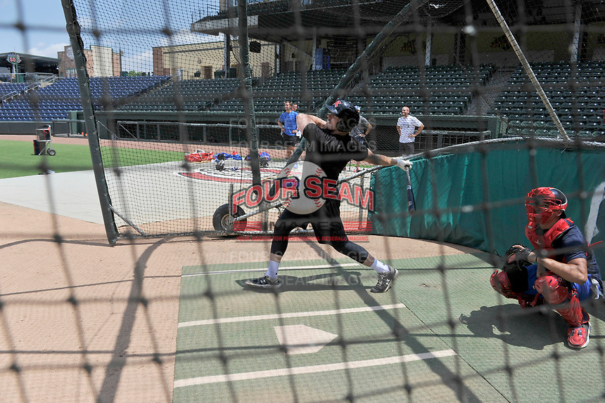 Chandler Redmond of the St. Louis Cardinals bats in the cage as Diego Cartaya of the Los Angeles Dodgers catches at a workout during the coronavirus shutdown with local Major League and Minor League players from around the Upstate on Tuesday, June 2, 2020, at Fluor Field at the West End in Greenville, South Carolina. (Tom Priddy/Four Seam Images)