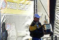 Nov. 10, 2012; Pomona, CA, USA: NHRA pro stock driver Allen Johnson celebrates after clinching the 2012 world championship during qualifying for the Auto Club Finals at at Auto Club Raceway at Pomona. Mandatory Credit: Mark J. Rebilas-