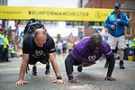 © Joel Goodman - 07973 332324 . 28/05/2017 . Manchester , UK . Runners at the finish line . The Great Manchester Run 2017 . Security is still heightened in Manchester following a murderous bomb attack at an Ariana Grande gig at Manchester Arena on Monday 22nd May . Photo credit : Joel Goodman