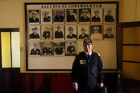 Bolivian Navy Captain Juan Rosas stands in an office in front of a board showing portraits of the former and current Naval Commanders at the Tiquina Naval Base, on Lake Titicaca on the day they mourn the loss of their ocean to Chile in the War of the Pacific.  Bolivia lost what is now northern Chile in a war over nitrates leaving Bolivia without access to the ocean.