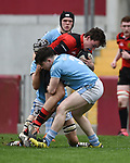 Keelan Butler of Ennis  in action against David Nevin of Garryowen during their U-18 Munster Club Final at Thomond Park. Photograph by John Kelly.