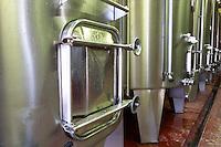 The vat cellar with stainless steel fermentation tanks. Detail of the door (manhole?) of a tank covered in condensation since it is cooled  Chateau de Haux Premieres Cotes de Bordeaux  Entre-deux-Mers  Bordeaux Gironde Aquitaine France