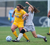 Kailey Blain (25) of Georgetown tackles the ball away from Maryam Huseini (10) of La Salle during the first round of the NCAA tournament at Shaw Field in Washington, DC.  Georgetown defeated La Salle, 2-0.