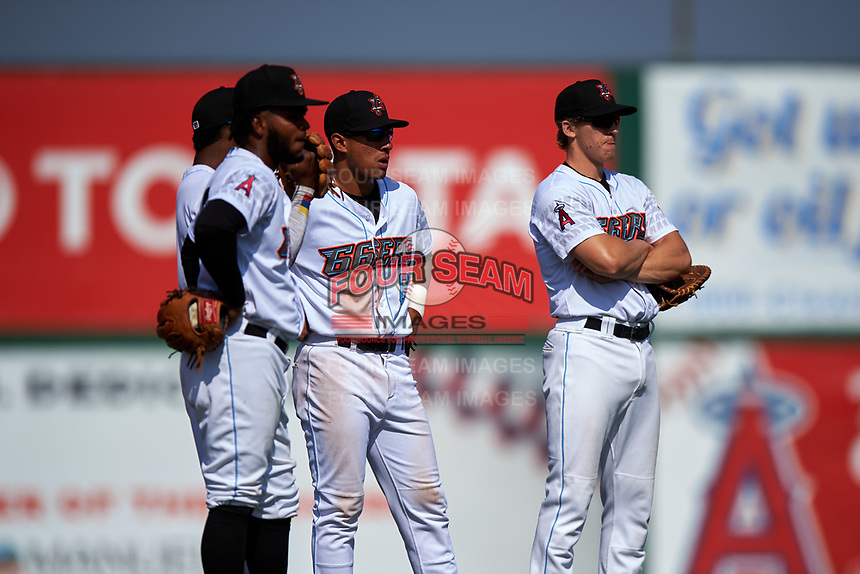 Inland Empire 66ers infielders Luis Rengifo (3), Alberto Triunfel (9), Jahmai Jones (8), and Jordan Zimmerman (5) talk through a pitching change during a California League game against the Lancaster JetHawks at San Manuel Stadium on May 20, 2018 in San Bernardino, California. Inland Empire defeated Lancaster 12-2. (Zachary Lucy/Four Seam Images)