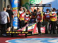 Nov 10, 2013; Pomona, CA, USA; Crew members with NHRA top fuel dragster driver Doug Kalitta during the Auto Club Finals at Auto Club Raceway at Pomona. Mandatory Credit: Mark J. Rebilas-