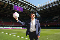 Lord Sebastian Coe meets poses with a match ball on the pitch ahead of Great Britain Women vs New Zealand Women - Womens Olympic Football Tournament London 2012 Group E at the Millenium Stadium, Cardiff, Wales - 25/07/12 - MANDATORY CREDIT: Gavin Ellis/SHEKICKS/TGSPHOTO - Self billing applies where appropriate - 0845 094 6026 - contact@tgsphoto.co.uk - NO UNPAID USE.