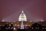 Falling snow highlights the Capitol dome's illuminating spotlights.