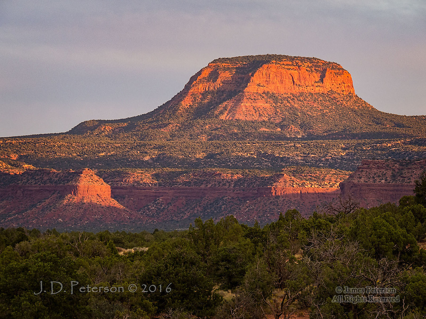Sunset at Fry Canyon, Utah ©2016 James D Peterson.  A warm summer sunset lights up this nameless butte in red rock territory.
